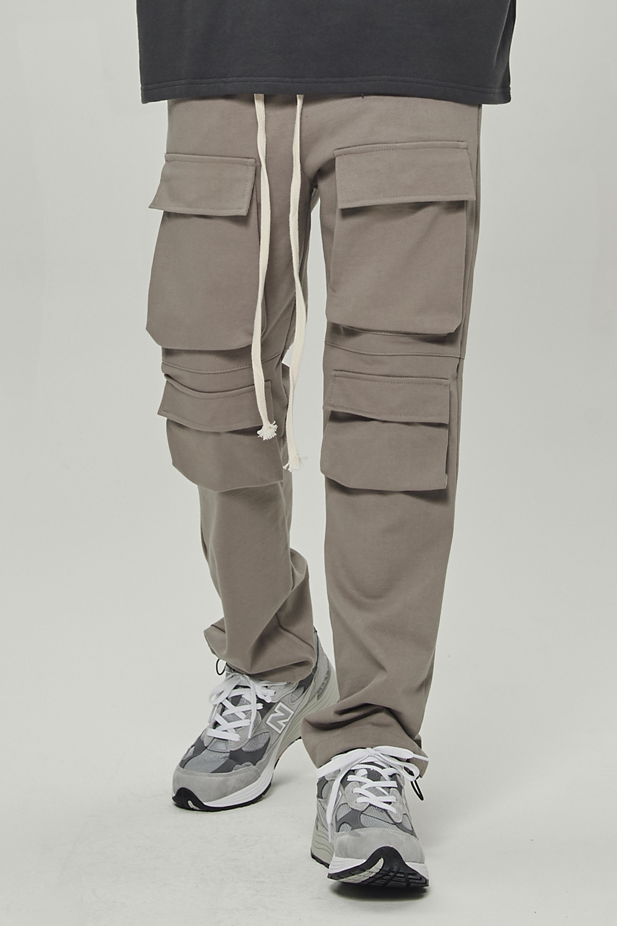 TAN MULTI POCKET CARGO STRING PANTS